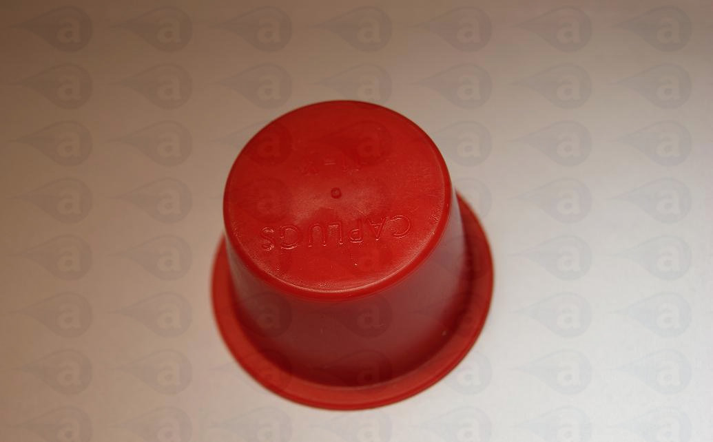 Syringe barrel end cap seal